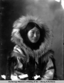 Portrait of an Eskimo woman in fur parka.