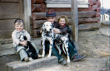Tim Redington, Joe Redington Jr. and Shelia Redington with dalmation Dutchess and puppy.