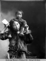 Mother carrying her child, Nome, Alaska.