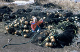 Heather Redington sitting on seine nets in Unalakleet.
