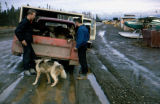 Man and Joe Redington Jr. stand behind dog truck at Lake Hood in Anchorage.