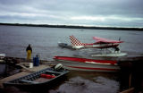 Fishing operation with Cessna 206 in background.