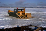 Boat under construction on snow or frozen surface.