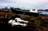 Fishing boat 'Miss Unalakleet' on shore.