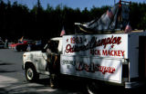 1983 Iditarod Champion Rick Mackey with his dog truck and dog sled on top.