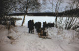 People gathered on the Iditarod Trail near Knik Lake, possibly for Raymie Redington's wedding.