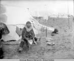 Man doing washing, Nome, Alaska.