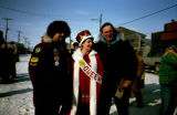 Leo Rasmussen and Don Young pose with Caroline Reeding, the 1983 All Alaska Sweepstakes Queen.