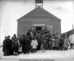 Mrs. Lehfeldt and her Eskimo friends at the Eskimo church on the sandspit at Christmas, Nome,...