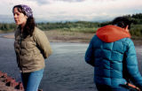 Emelita Brown and another woman stand near the north fork of the Unalakleet River.