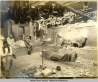 Interior of an Indian Hut, Yakutat Bay. Indian wounded in bear fight.