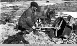 Man with mining equipment near Bonanza City, Alaska.