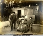 "An Indian family ""dressed for a picture."" Chilcat [Chilkat], Alaska."