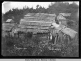 Log cabin with grass roof in Seldovia, Alaska.