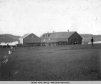 Parade grounds of Sitka Marine Barracks, Capt. Pendleton sometime 1890s.