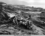 Army bulldozer works in mud on Kiska Island, August 1943.