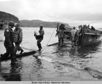 U. S. forces land ammunition at Kiska Harbor, August 1943.
