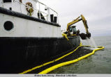 M/V GLACIER scoops oily debris in Cook Inlet.
