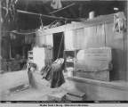 Interior of an Indian Hut. Indian Papoose. Chilcat [Chilkat] , Alaska.