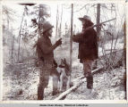 Prospectors and dog, hunting for game.
