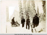 Prospectors pull loaded sled through deep snow at 45 below.