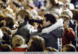 Photographer in crowd at President Ford's arrival at Eielson AFB, 1975.