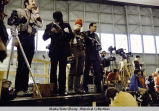 Press corps photographers await President Ford at Eielson AFB, 1975.