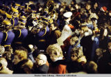 Crowd and marching band await President Ford in Alaska, 1975.