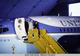 President and Mrs. Ford disembark from Air Force One in Alaska, 1975.