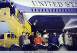 Dignitaries, including Henry Kissinger, disembark from Air Force One in Alaska, 1975.