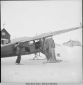 Pilot Sig Wien scrapes ice, Igloo [Marys Igloo], Alaska, 3/1942.