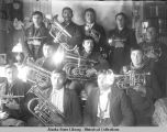 Group of men with brass instruments.