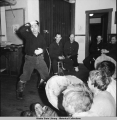 Eskimo dancer clowning at expense of visitors, Point Lay School, 3/1942.