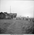 Native boys backpacking freight to teachers' quarters, Perryville, Alaska, 11/1940.