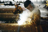 Welding on Trans-Alaska Pipeline, 1976.