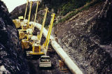 Pipeline construction through mountain pass, 1976.