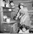 Sahar John, cooking for potlatch, Venetie, Alaska, 3/1939.