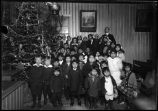 Children around Christmas tree, Yakutat, Alaska.