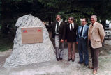 Canadian and U.S. officials next to Klondike Highway plaque, June, 1981.