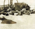 Coast guardsmen rest on deck of NORTHLAND.