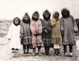 Six Eskimo girls wearing summer parkas.