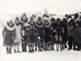 Children pose in winter parkas.