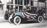 Dignitaries in flag-draped car, Nome.