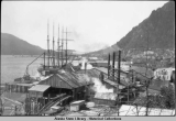 Juneau Lumber Mills with 5-masted barkentine, c. 1923.