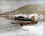 Lockheed Vega in winter with dog team.