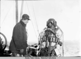 The sinking of the Princess Sophia. (8) Diver in helmet and diving suit, preparing to decend to...