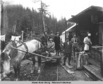 Group with horse-drawn tram at lower camp, Jualin mine, 1914.