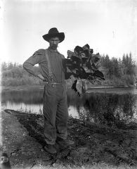[Man with large plant.]