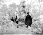 [Snow scene with three men.]