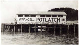 Building sign, advertising Wrangell Potlatch, June 1940.